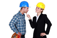 Architect flirting with builder Stock Photos