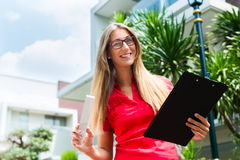 Architect with folding rule in front of house Stock Photos