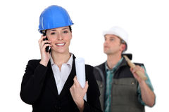 An architect and a foreman. Stock Image