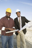 Architect And Foreman At Construction Site Stock Photo