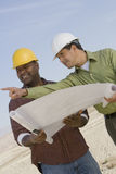 Architect And Foreman In Discussion Royalty Free Stock Image