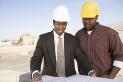 Architect And Foreman In Discussion At Site Royalty Free Stock Photos