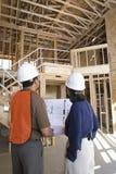 Architect With Foreman Examining Framework Stock Images