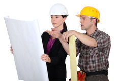 Architect and foreman having debate Stock Photos