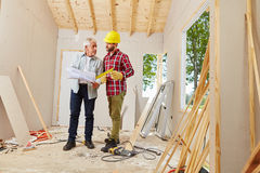 Architect and foreman working Stock Photos