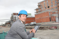 Architect in front of construction building Royalty Free Stock Photo