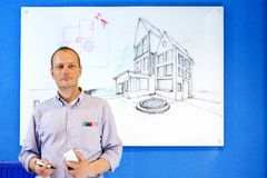 Architect in front of white board Royalty Free Stock Photo