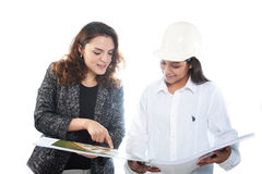 Architect girl with contractor girl royalty free stock images