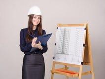 Architect girl writes theses folder Stock Photography