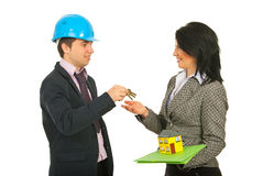 Architect giving keys to owner Stock Photo