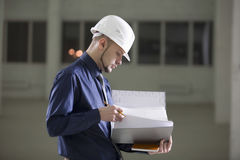 Architect Going Through File Folder In Warehouse Stock Photos