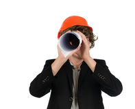 Architect goofing around spying with a blueprint Royalty Free Stock Photo