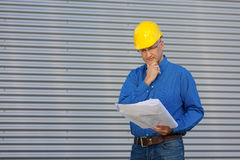 Architect With Hand On Chin Looking At Blueprint Against Shutter Stock Photography