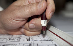 Architect Hand. Architect drawing house architecture plans Royalty Free Stock Photography