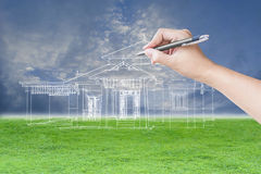 Architect hand drawing a house Stock Photography
