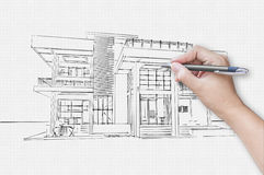 Architect hand drawing a house Stock Image
