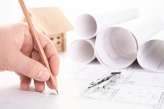 Architect hand with pencil drawing royalty free stock photo