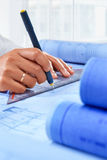 Architect hand working on paperwork Royalty Free Stock Images