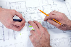 Architect hands. Architects working, drawing some plans. Studio Shot royalty free stock photography