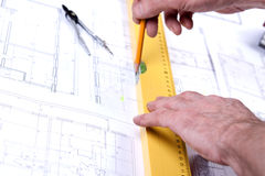 Architect hands. Architects working, drawing some plans. Studio Shot Royalty Free Stock Images
