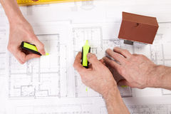 Architect hands. Architects working, drawing some plans. Studio Shot Royalty Free Stock Image