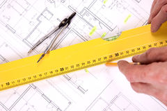 Architect hands. Architects working, drawing some plans. Studio Shot Royalty Free Stock Photos