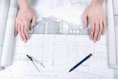 Architect hands. Architects working, drawing some plans. Studio Shot Stock Photography