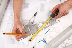 Architect hands. Architects working, drawing some plans. Studio Shot Stock Photo
