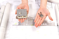 Architect hands. Architects working, drawing some plans. Studio Shot Stock Image