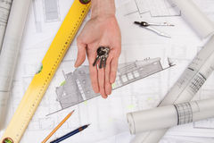 Architect hands. Architects working, drawing some plans. Studio Shot Stock Photos
