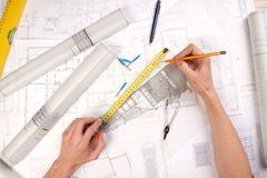 Architect Hands. Construct plans, maps and tools. Architecture stock image