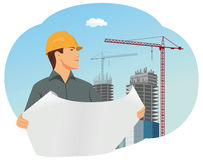 Architect. With a hard hat is checking a structural drawing Stock Photography