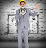 Architect with hard hat shouting with a megaphone Royalty Free Stock Image