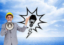 Architect with hard hat shouting with a megaphone Stock Image