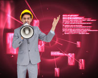 Architect with hard hat shouting with a megaphone Stock Photos