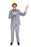 Architect with hard hat shouting with a megaphone Royalty Free Stock Photo