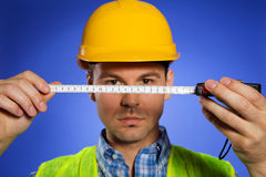 Architect in hardhat holding tape measure Stock Photography