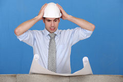 Architect having a hard time. Royalty Free Stock Image