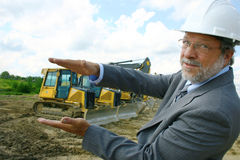 Architect with heavy equipment Royalty Free Stock Image