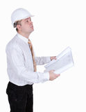 Architect in helmet, with blueprint Stock Photo