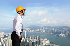 Architect with helmet looking city building Stock Images