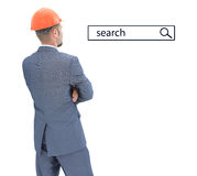 Architect in helmet  looking at search line Stock Photography