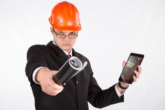 Architect in helmet and with the tablet Stock Photography
