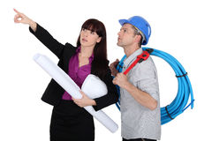 An architect and her plumber Royalty Free Stock Image