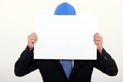 Architect hiding behind board Stock Photo
