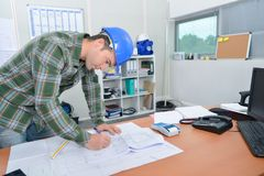 Architect at his desk stock images