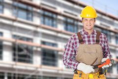Architect holding adjustable wrench against building Royalty Free Stock Photo