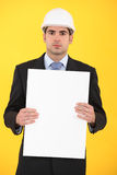 Architect holding advertising panel Stock Photo