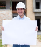 Architect holding a banner Royalty Free Stock Photography