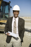 Architect Holding Blueprint At Construction Site Royalty Free Stock Image